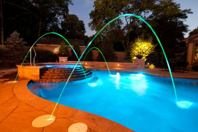 Blue fountain pools freeform pools for Pool jets design